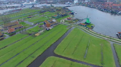 Netherlands Windmill Village, Flyover Field Viewing Homes & Windmills Stock Footage