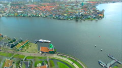 Netherlands Windmill Village Flyover Water To Water Front Homes - stock footage
