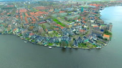 Netherlands Windmill Village Fly Towards Water Front Buildings Stock Footage