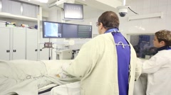 Doctor and nurse conduct cardio-vascular examination by angiograph Stock Footage