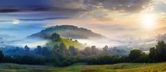 mysterious fog on hillside in rural area - stock photo