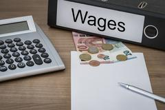 Wages written on a binder - stock photo