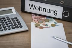 Wohnung written on a binder Stock Photos