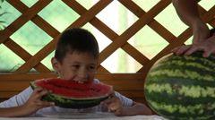 Boy eating watermelon Arkistovideo