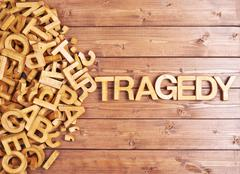 Word tragedy made with wooden letters - stock photo