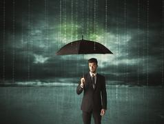 Business man standing with umbrella data protection concept Kuvituskuvat