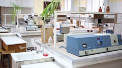 Different devices on tables in empty chemical laboratory Stock Footage