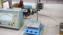 Magnetic stirrer with heating, millivoltmeter in chemical laboratory Stock Footage