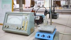 Male hand turns on and configures magnetic stirrer with heating Stock Footage