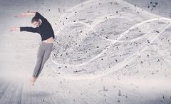 Performance ballet dancer jumping with energy explosion particles Kuvituskuvat