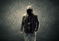 Spooky faceless guy standing in hoodie - stock photo
