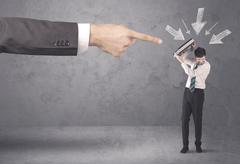 Amateur businessman under pressure - stock photo