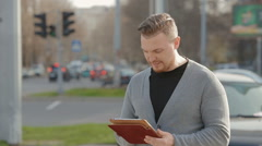 Close-up of the man who corresponds with someone in the tablet Stock Footage
