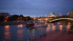 Great Stone Bridge, Kremlin and sailing ships in Moscow night Stock Footage