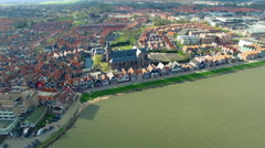 Volendam town in North Holland Over Green Water View Of Beach Front Homes Stock Footage