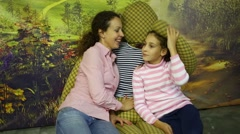 Happy woman and girl play in room with big straw doll Stock Footage