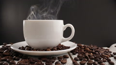 Cup of coffee on black background Stock Footage