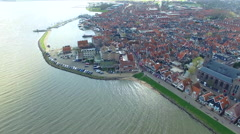 Volendam town in North Holland Ariel View Flying Towards Shore Stock Footage