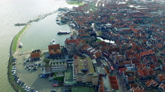 Volendam town in North Holland Flying Over Redtop Homes Slowly Descending Stock Footage