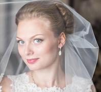 Beautiful bride with fashion wedding hairstyle. Closeup portrait of young Kuvituskuvat