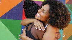 Women meeting and hugging on the park, slow motion Stock Footage