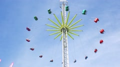 Big chain merry-go-round with people turns around in height in funfair - stock footage