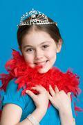 Girl with tiara and feather boa Stock Photos