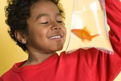 Boy with a goldfish Kuvituskuvat