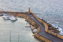 KYRENIA, NORTHERN CYPRUS - NOVEMBER 29, 2015: people walking by the pier at - stock photo