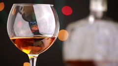 Cognac. Pouring Brandy from a Bottle Stock Footage