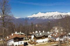 ROSA KHUTOR, RUSSIA - APRIL 01, 2016: Mountain ski resort Rosa Khutor and - stock photo