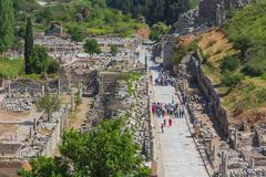 SELCUK, TURKEY - MAY 3, 2015: tourists watching ruins of ancient Ephesus - stock photo