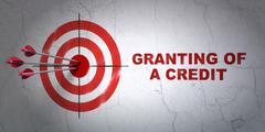 Currency concept: target and Granting of A credit on wall background Piirros