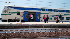 People get in and out of the modern passenger train at the station Corniglia Stock Footage