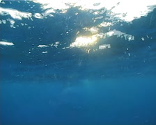 Ocean scenery shot begins subsurface, on boat on the surface, at sunset, UP12690 Stock Footage