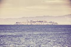 Retro old film stylized picture of Alcatraz island. Stock Photos