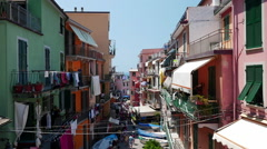 Small street of beautiful Riomaggiore village in the Cinque Terre is full of Stock Footage