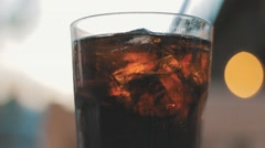 Attractive shot of Coke (Cola) Fizzing. Stock Footage