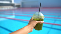 Healthy Living Diet Detox Juice and Swimmer Woman by Sports Swimming Pool - stock footage