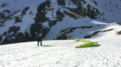 Ready to skyjump from a snowcovered mountain in Chamonix - green parachute Stock Footage