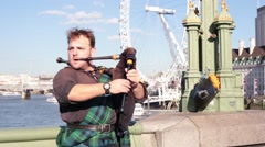 Video of a unidentified bagpiper playing in London for editorial use only. Stock Footage
