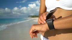 Smartwatch And Smart Phone On Beach - Woman In Bikini Using Wearable Tech - stock footage