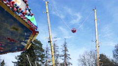 People in ball swing on rope between two pole Stock Footage