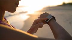 Woman Touching Smartwatch On Beach - Smart Watch Wearable Technology Stock Footage