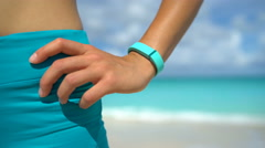 Activity Tracker on Fit Woman Wrist At Beach - Fitness Tracker Wearable Tech Stock Footage