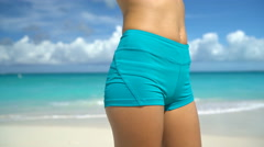Fit sporty woman hips, female lower body closeup Young adult wearing sexy shorts Stock Footage