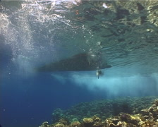 Ocean scenery skiff driving away shot from below, on shallow coral reef, UP13068 Stock Footage