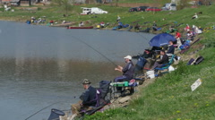 Feeder fishing competition on the lake, anglers by Pakito. Stock Footage