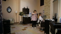 Hairdresser woman dries the hair dryer Stock Footage