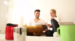 A young couple discussion their financial situation Stock Footage